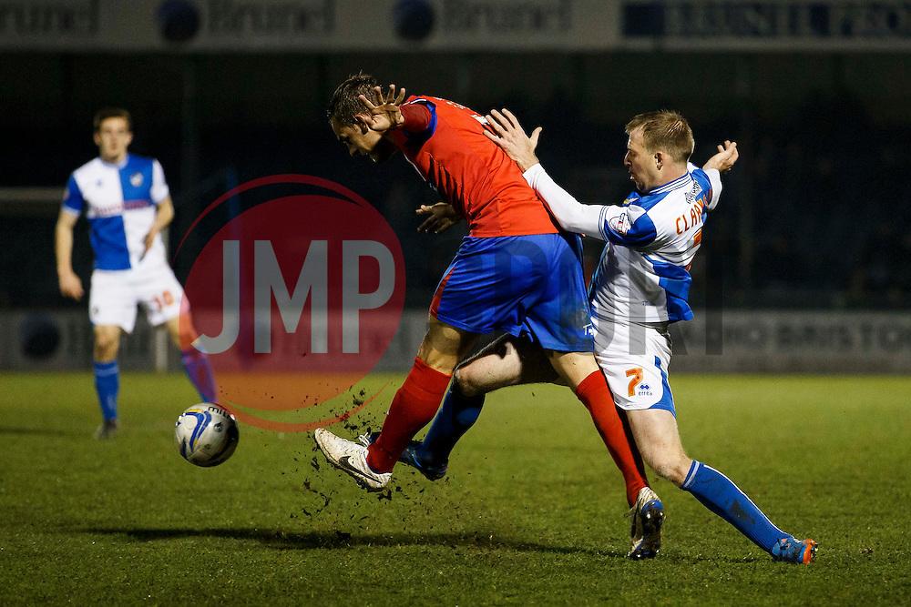 Dagenham & Redbridge Defender Luke Wilkinson (ENG) is tackled by Bristol Rovers Forward David Clarkson (SCO) - Photo mandatory by-line: Rogan Thomson/JMP - 07966 386802 - 11/03/2014 - SPORT - FOOTBALL - Memorial Stadium, Bristol - Bristol Rovers v Dagenham & Redbridge - Sky Bet League Two.