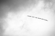 A plane flies over Augusta National Golf Club with a message for Tiger Woods during the first round of the Masters at Augusta National Golf Club in Augusta, GA.