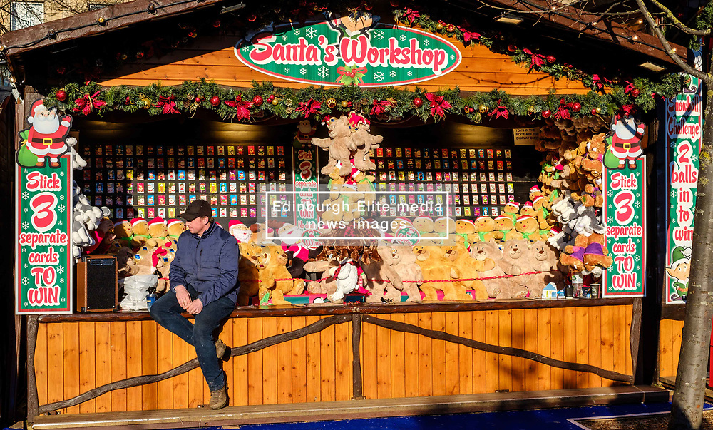 Edinburgh's Christmas 2019: a stallholder in Princes Street Gardens waiting for customers