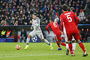 Liverpool forward Roberto Firmino (9) pushes forward with the ball during the Champions League match between Bayern Munich and Liverpool at the Allianz Arena, Munich, Germany, on 13 March 2019.