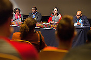 """Panelist speak on the subject of """"Michael Johnson Survival of the Fastest: Myth Science or Stereotype?"""" during the roundtable portion of the Sports in Africa and the Global South Conference at Ohio University.  Photo by Ohio University / Jonathan Adams"""