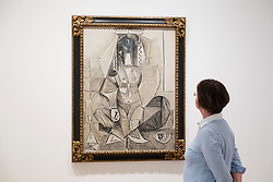 Visitor looking at painting by Picasso at Berggruen Museum in Berlin Germany