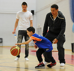 James Tavernier plays basketball with a fan - Photo mandatory by-line: Dougie Allward/JMP - Mobile: 07966 386802 - 27/02/2015 - SPORT - basketball - Bristol - SGS Wise Campus - Bristol Flyers v Leeds Force - British Basketball League