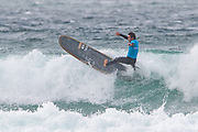 Benoit Carpentier executes a turn 'off the lip' during the Boardmasters Longboard Pro at Fistral Beach, Newquay, Cornwall, United Kingdom on 10 August 2019.
