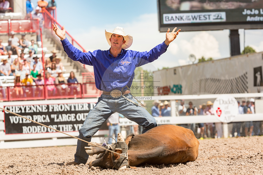 Steer roper JoJo LeMond of Andrews, Texas celebrates after roping his steer to win overall Cowboy during the finals at the Cheyenne Frontier Days rodeo in Frontier Park Arena July 26, 2015 in Cheyenne, Wyoming.