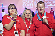 Abu Dhabi, United Arab Emirates - 2019 March 15: (L) Patrycja Scheibe with her bronze medal in roller skating and (C) coach Joanna Bek and (R) Krzysztof Wieczorek with his silver medal in roller skating all from SO Poland during Special Olympics World Games Abu Dhabi 2019 on March 15, 2019 in Abu Dhabi, United Arab Emirates. (Mandatory Credit: Photo by (c) Adam Nurkiewicz)