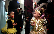 Xavier Mascareñas/The Daily Times; Amari Salazar, 3, who is dressed as a bee, and princess Lacie Kay, also 3, eye each other's costumes outside the cake-walk room at the Bloomfield, N.M, Police Department during the BPD and Police Athletic League's annual Halloween carnival Oct. 29, 2009.