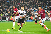 Fulham Forward Aleksandar Mitrovic (9) and West Ham United Defender Ryan Fredericks (24) in action during the Premier League match between West Ham United and Fulham at the London Stadium, London, England on 22 February 2019.