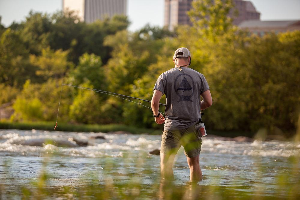 Smallmouth Bass fishing on the James River. Richmond city skyline.