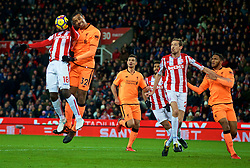 STOKE-ON-TRENT, ENGLAND - Wednesday, November 29, 2017: Liverpool's Joel Matip and Stoke City's Mame Diram Diouf during the FA Premier League match between Stoke City and Liverpool at the Bet365 Stadium. (Pic by David Rawcliffe/Propaganda)