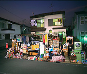The Ukita Family in front of their home with all of their possessions, Tokyo, Japan. Published in Material World: A Global Family Portrait, page 48-49. From Peter Menzel's Material World: A Global Family Portrait Project that showed 30 statistically average families in 30 countries with all their possessions.