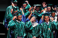 Seniors turn their tassels during the Chaminade Julienne High School Class of 2012 commencement exercises at the Schuster Center in downtown Dayton, Monday, May 21, 2012.