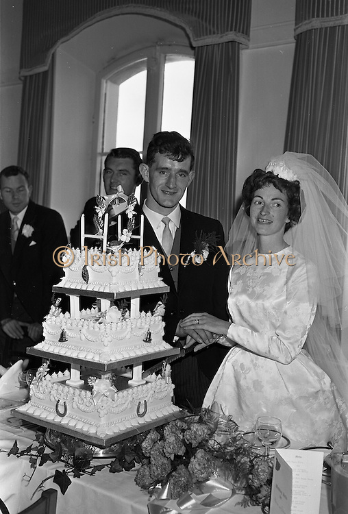 05/09/1962<br /> 09/05/1962<br /> 05 September 1962<br /> Wedding of Fergus Keogh of &quot;Eagleville&quot;, Strandville Avenue, Clontarf, Dublin to Miss Miriam Caffrey, Church Avenue, Drumcondra Dublin at the Church of the Visitation of the BVM, Fairview with reception at St. Lawrence Hotel, Howth. Mr. keogh was full-back for Bective Rangers at the time. Cutting the cake!