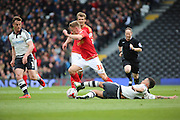 Fulham defender Ryan Fredericks (07) fouling Nottingham Forest midfielder Ben Osborn (38) during the Sky Bet Championship match between Fulham and Nottingham Forest at Craven Cottage, London, England on 23 April 2016. Photo by Matthew Redman.