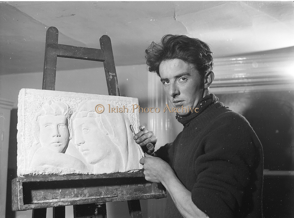 """16/02/1955<br /> 02/16/1955<br /> 16 February 1955<br /> Artist and Sculpture Edward Delaney with his Stone Craving """"Madonna and Child"""" ."""