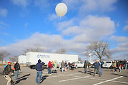 People watch as Iowa High Altitude Balloon Project, Cedar Valley Amateur Radio Club, Collins Amateur Radio Club, and Rockwell Collins, Inc. launch a high altitude balloon to start Engineers Week at Rockwell Collin in Cedar Rapids on Saturday, February 16 2013.