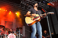 Luke Bryan performs at the 31st annual Country Concert in Fort Loramie, Ohio, Thursday, July 7, 2011.