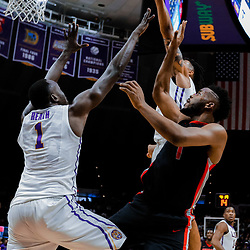 Jan 16, 2018; Baton Rouge, LA, USA; LSU Tigers forward Wayde Sims (44) blocks a shot by Georgia Bulldogs forward Yante Maten (1) as forward Duop Reath (1) defends during the first half at the Pete Maravich Assembly Center. Mandatory Credit: Derick E. Hingle-USA TODAY Sports