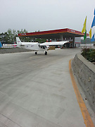 BEICHUAN, CHINA - APRIL 8: (CHINA OUT) <br /> (Photo taken by mobile phone)<br /> Pilot Fills Up Plane At Petrol Station After Running Out Of Fuel<br /> <br /> A Model CH750 plane lands at a petrol station for oil filling on April 8, in Beichuan County, Sichuan Province of China. A Model CH750 plane under a test flight landed at a petrol station and filled up with 20L #97 gasoline in Beichuan County of Southwest China Sichuan Province. One of the pilot is a 55-year-old American and both of the pilots are from a local branch of an American plane manufacturer. The poilt told the petrol station staff they landed because they had ran out of fuel but this behavior is violation according to Chinas low-altitude airspace management regulations.<br /> ©Exclusivepix