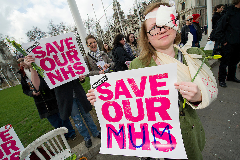 NHS RIP. A last ditch protest against the NHS bill takes place in Parliament Square on Mother's Day, also the eve of it being passed in the House of Commons. © Guy Bell Photography, GBPhotos