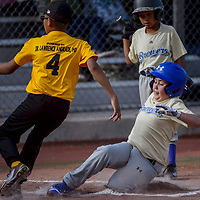 Brewer Camron McDaugale (8) steals home ahead of the tag from Pirates pitcher Kaneen Manuelito (4) Thursday at Ford Canyon Park.
