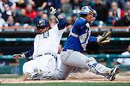April 25, 2013; Detroit, MI, USA; Detroit Tigers first baseman Prince Fielder (28) slides in safe at home as Kansas City Royals catcher Salvador Perez (13) make the catch fourth inning at Comerica Park. Mandatory Credit: Rick Osentoski-USA TODAY Sports