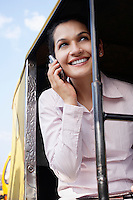 Business woman on cell phone smiling
