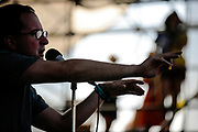 The Hold Steady lead singer Greg Finn sings on the West Stage of Virgin Freefest at Merriweather Post Pavilion in Columbia, Md.