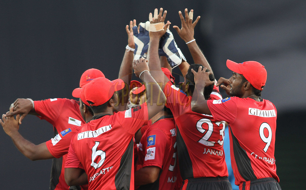 Ruhunu Eleven celebrate a wicket during the Q1 match between Trinidad & Tobago and Ruhunu Eleven held at the Rajiv Gandhi International Stadium, Hyderabad on the 19th September 2011..Photo by Shaun Roy/BCCI/SPORTZPICS