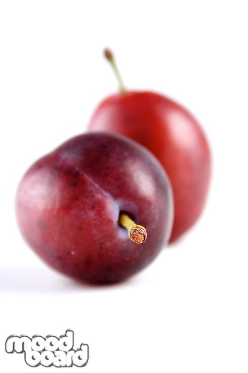 PluStudio shot of plums on white background