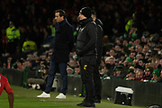 Celtic Manager Neil Lennon stands in the technical area alongside his Rennes counterpart Manager Julien Stephan during the Europa League match between Celtic and Rennes at Celtic Park, Glasgow, Scotland on 28 November 2019.