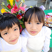Bunun flower girls pose in front of collection table at a weddint in Namasiya Township, Kaoshiung County, Taiwan