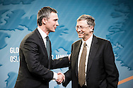 Bill Gates and Norwegian PM Jens Stoltenberg shaking hands after talking about international health at Astrup Fearnley Museum.