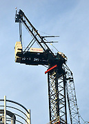© Licensed to London News Pictures. 16/01/2013. London, UK. A damaged crane is seen hanging from the side of the St George's Wharf development near Vauxhall in in London today (16/01/13) after a being hit by a helicopter, which then crashed.  Photo credit : Stephen Simpson/LNP