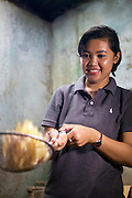 Panglipur Binurissamsika (known as Elip) with some of her home made crisps.<br /> <br /> Elip is 23 years old and runs her own business selling home made crisps, with her friend and business partner is Kirman Nurbin <br /> <br /> Initially they were making a loss but the training course on bookkeeping taught her how to record finances so that she prices her goods appropriately.