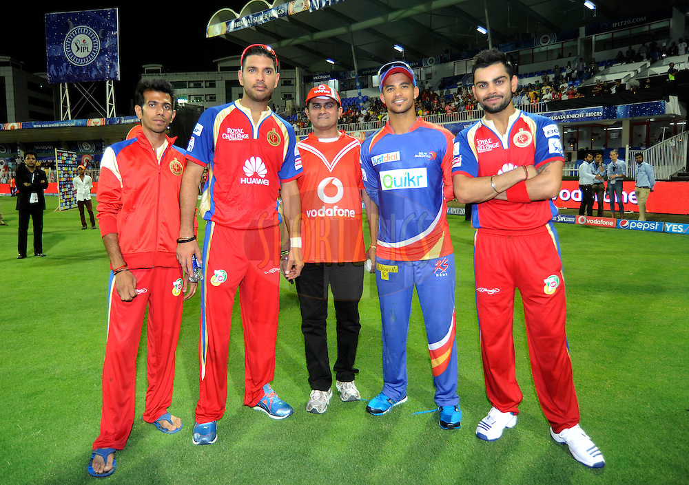 Yuzvendra Chahal of the Royal Challengers Bangalore (L to R) Yuvraj Singh of the Royal Challengers Bangalore, Vodafone Winner, Jean-Paul Duminy of the Delhi Daredevils and Virat Kohli captain of the Royal Challengers Bangalore during the presentation after match 2 of the Pepsi Indian Premier League Season 7 between the Delhi Daredevils and The Royal Challengers Bangalore held at the Sharjah Cricket Stadium, Sharjah, United Arab Emirates on the 17th April 2014<br /> <br /> Photo by Pal Pillai / IPL / SPORTZPICS