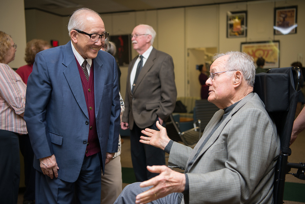 Dr Hwa- Wei Lee (Left) and Dr. Charles Ping greet one another at Alden Library. Photo by Ben Siegel