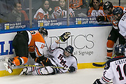 RIT forward Myles Powell takes down Robert Morris defenseman Chase Golightly during the Atlantic Hockey final at the Blue Cross Arena in Rochester on Saturday, March 19, 2016.