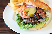 Hamburger with goose and french fries