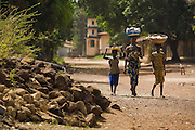 A woman and children walk throught the village of Mabanta on Friday February 27, 2009.