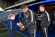 Portsmouth players sign their autograph for a young fan on arrival at the Kassam Stadium ahead of the Leasing.com EFL Trophy match between Oxford United and Portsmouth at the Kassam Stadium, Oxford, England on 8 October 2019.