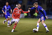 Walsall defender Jason Demetriou  and Gillingham midfielder Josh Wright during the Sky Bet League 1 match between Gillingham and Walsall at the MEMS Priestfield Stadium, Gillingham, England on 12 April 2016. Photo by Martin Cole.
