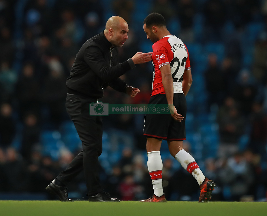 Manchester City's Pep Guardiola has words with Southampton's Nathan Redmond as the players leave the field