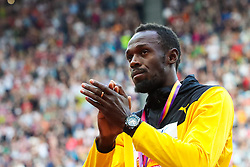 London, 2017 August 06. Men's 100m bronze medalist Usain Bolt applauds the crowd at the medal ceremony on day three of the IAAF London 2017 world Championships at the London Stadium. © Paul Davey.