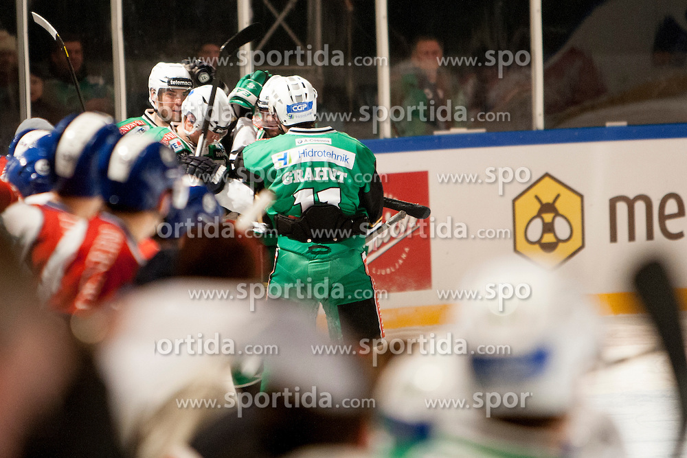 06.01.2013, Stadium Bezigrad, Ljubljana, SLO, EBEL, HDD Telemach Olimpija Ljubljana vs KHL Medvescak Zagreb 39. Runde, in picture players of HDD Telemach Olimpija celebrate goal during the Erste Bank Ice Hockey League in 39th Round match between HDD Telemach Olimpija Ljubljana and KHL Medvescak Zagreb at the open ice winter classic Stadium Bezigrad, Ljubljana, Slovenia on 2013/01/06. (Photo By Urban Urbanc / Sportida.com)