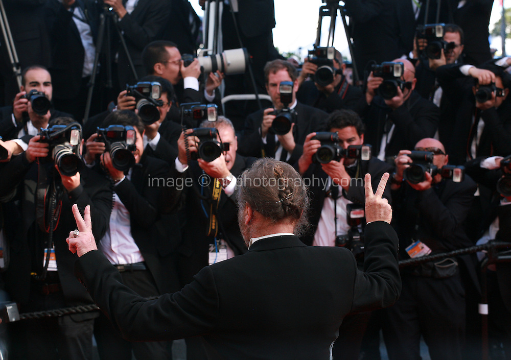 Franco Nero with photographers at the Palme d'Or  Closing Awards Ceremony red carpet at the 67th Cannes Film Festival France. Saturday 24th May 2014 in Cannes Film Festival, France.