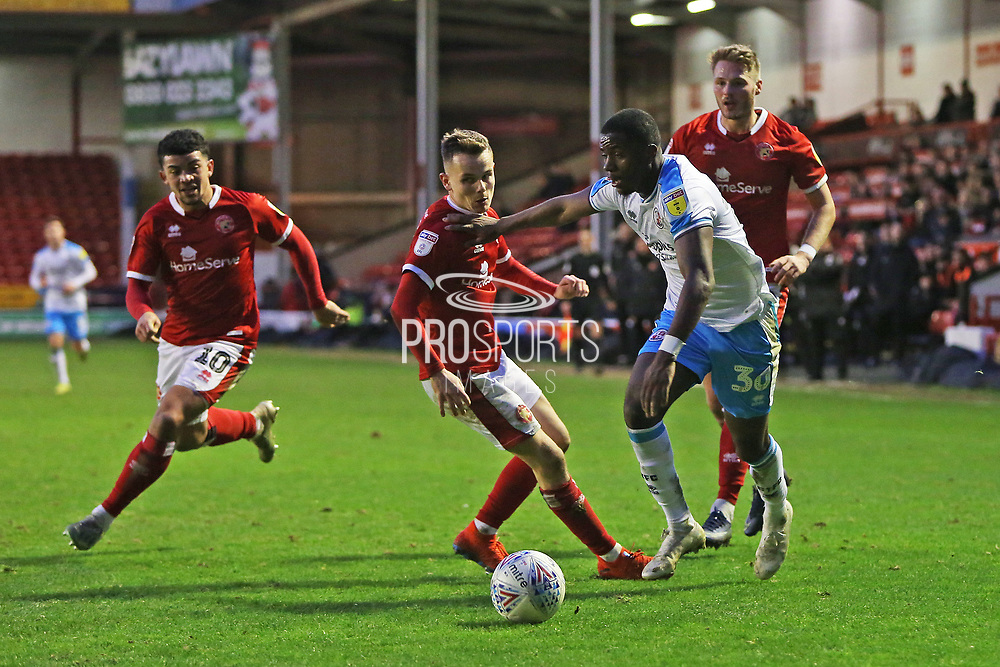 Bez Lubala runs past Liam Kinsella during the EFL Sky Bet League 2 match between Walsall and Crawley Town at the Banks's Stadium, Walsall, England on 18 January 2020.