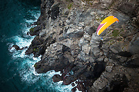 Paraglider pilot Gavin McClurg soars along steep cliffs in the Azores where a small change in the winds would end in disaster.
