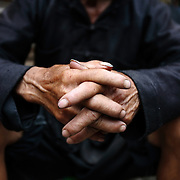 A Hmong man folds his hands at a market in Ha Giang, Vietnam's northernmost province.