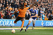 Wolverhampton Wanderers defender Dominic Iorfa  clears from Ipswich Town defender Jonas Knudsen during the Sky Bet Championship match between Wolverhampton Wanderers and Ipswich Town at Molineux, Wolverhampton, England on 2 April 2016. Photo by Alan Franklin.
